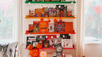 Rainbow bookshelves with Halloween kids books on them