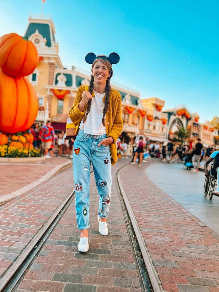Woman at Disneyland in patch jeans for Halloween