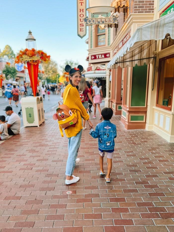 Mom and son walking down Main Street at Disneyland Halloween Time