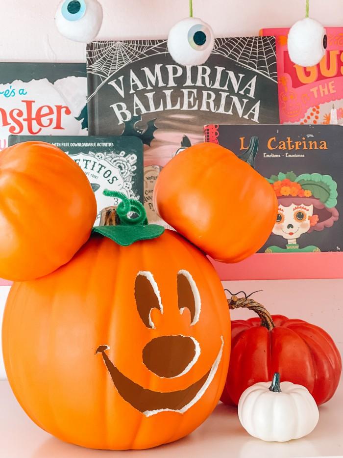 Mickey pumpkin in front of Halloween books