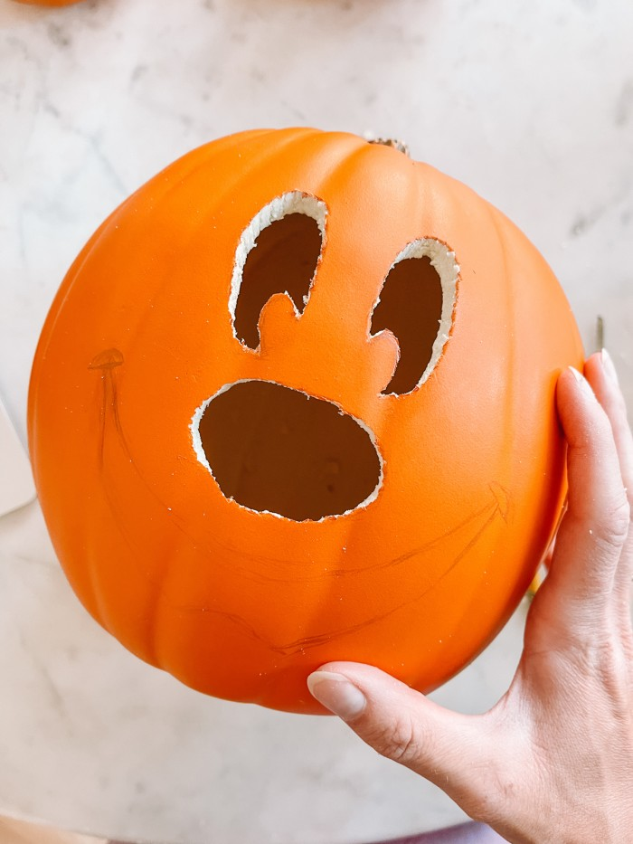 pumpkin with mickey face partially carved